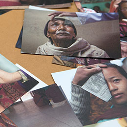 Pictures of sight giving beneficiaries scattered on a table.