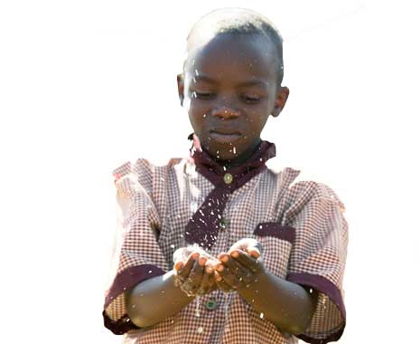 Child receives the gift of safe water.